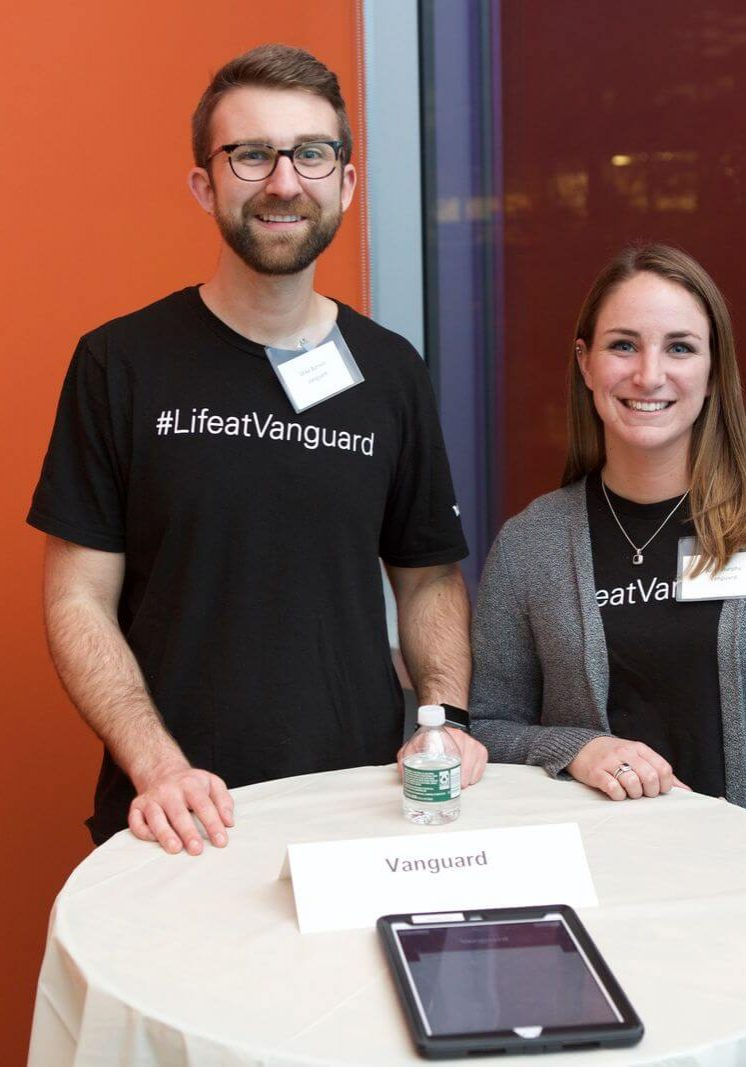 Vanguard employers wearing black shirt with #LifeatVanguard logo